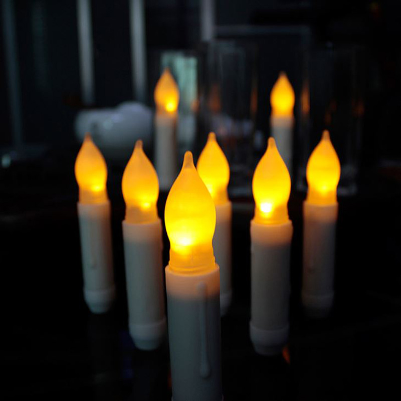 Set Of 12 Yellow Mini Battery Operated Wax Dipped White Body LED Taper Candles