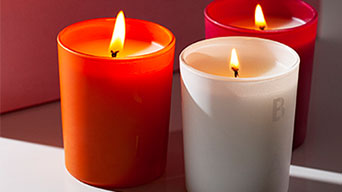 A collection of three petite French scented candles