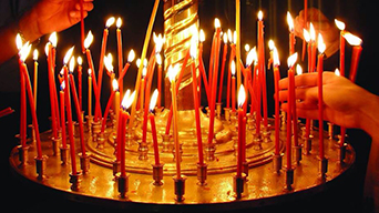 Why do we light orthodox church candles at church?